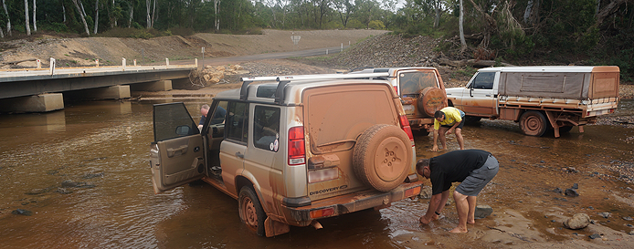 "Washing vehicles in the river on return from Cape York - part way home the police ""lay"" in wait for obsured number plates on vehicles."