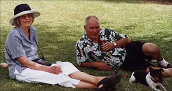Pat and Peter relaxing on the grass with a cool drink